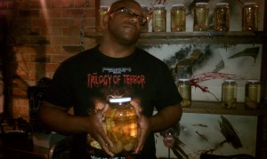 "Holding a ""specimen"" at Eli Roths Goretorium in Las Vegas.  I'm wearing the Trilogy Of Terror shirt.  I got that shirt after working in a House Of Horrors as a Military Executioner during halloween."