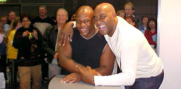 "That's me with Celebrity-Chef Ainsley Harriott at the Sydney ""Good Food Show"". He is as jovial in person as he is on TV! Think he'll put this picture of us in his next book?! ""Recipe For Success!"""