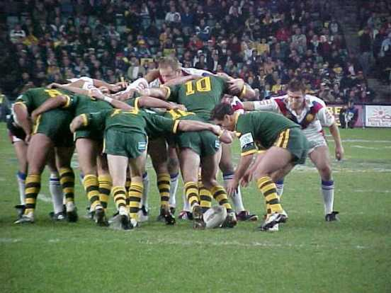 """Going to my first """"Footy"""" (Rugby to you) game I didn't know exactly what to expect but from the energy in the crowds I knew it'd be pretty intense. Well I was not disappointed! The Aussie team was playing England. The newspapers wrote articles about just how badly Team OZ was going to beat the Poms (English), and they were absolutely correct! By halftime they had a 40 to nil lead and showed no mercy. I even saw one player get knocked completely unconscious after an unsuccessful tackle!"""